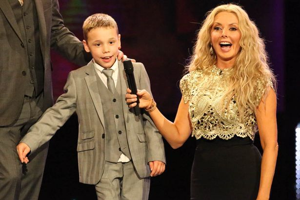 Child of Courage winner Bailey Matthew and host Carol Voderman at the Daily Mirror Pride of Britain Awards 2015 at the Grosvenor House Hotel, London