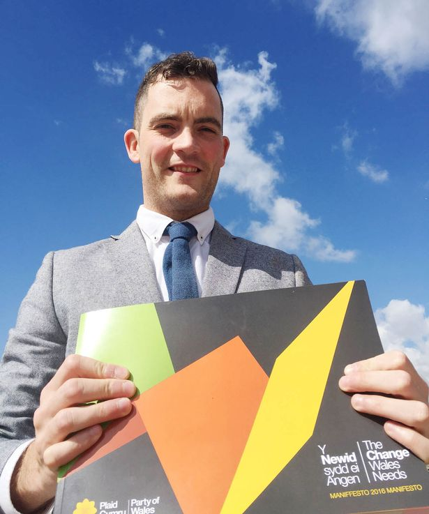 Former Big Brother contestant Glyn Wise with a copy of his party's manifesto at Cardiff and Vale College as he is standing as Plaid Cymru's candidate in Cardiff Central