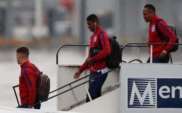 England's Ross Barkley, Marcus Rashford and Nathaniel Clyne arrive back at Manchester Airport