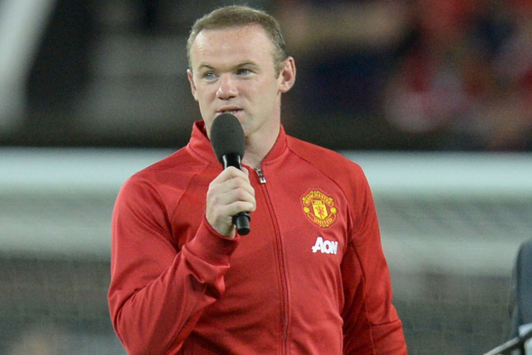 Wayne Rooney talks to the fans at the end of the testimonial