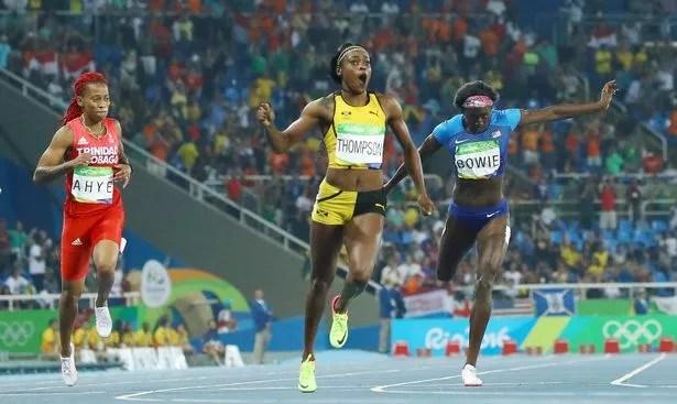 Elaine Thompson (JAM) of Jamaica (C) runs to win the gold