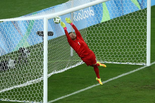 Timo Horn of Germany can't save a free kick from Neymar of Brazil to score the first Brazil goal during the Men's Football Final between Brazil and Germany