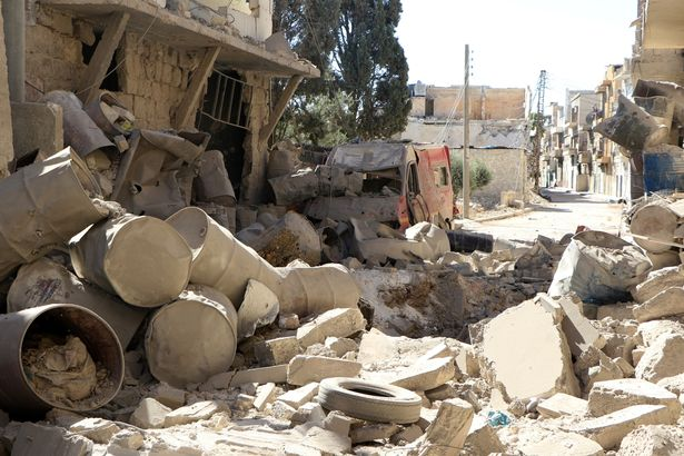 A wreckage of collapsed buildings around the Sahra Hospital are seen after a barrel bomb strike by Syrian regime forces over Sahur neighborhood of Aleppo, Syria