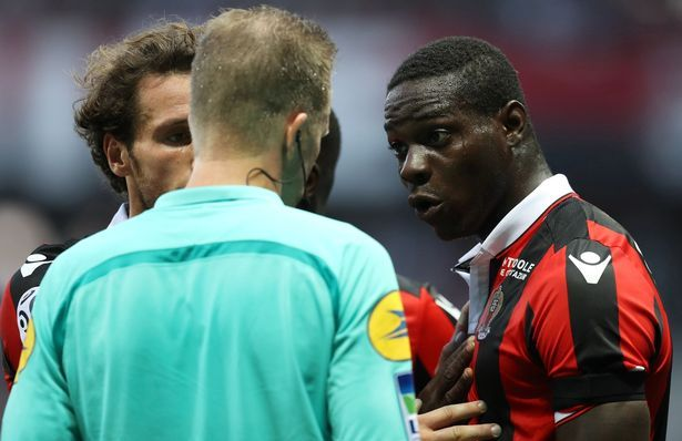 Mario Balotelli reacts after receiving a red card