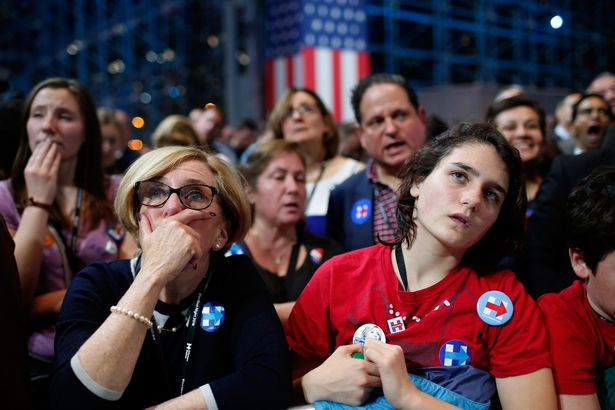 People watch voting results at Democratic presidential nominee former Secretary of State Hillary Clinton's election night event at the Jacob K. Javits Convention Center