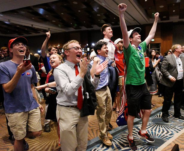 Supporters of U.S. Republican candidate Donald Trump celebrate after the networks called their candidate's victory