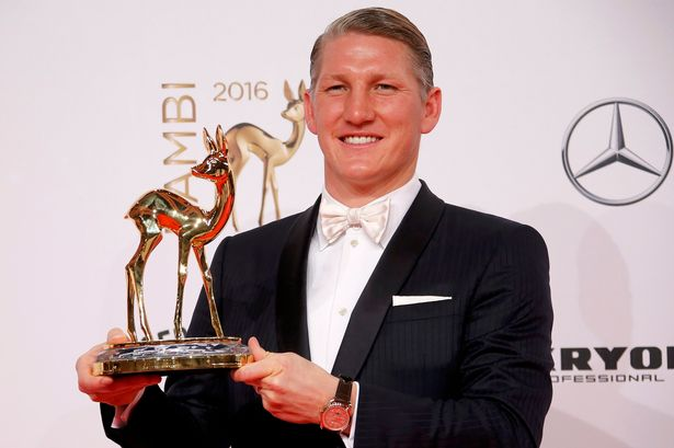 Bastian Schweinsteiger poses with the Special Jury award