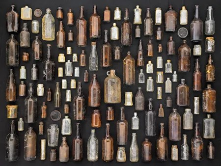 Brown and Clear Glass Bottles and Jars by Barry Rosenthal