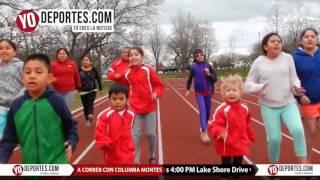 Niños padres y abuelos corren con la Atleta del Año Columba Montes