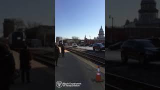 Charger pulls Amtrak train