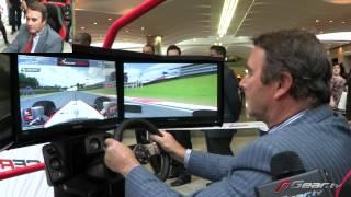 Nigel Mansell playing F1 racing game