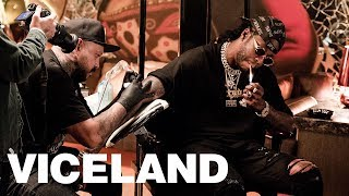 2 Chainz Gets Tattooed with Ink from a Motorcycle