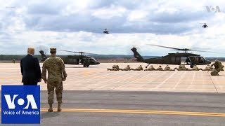 Trump observes military demonstration, signs the National Defense Authorization Act