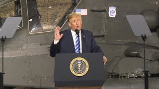 President Trump signs military spending act at Fort Drum
