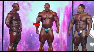 Phil Heath could not Control his Gut between poses ( Footage)