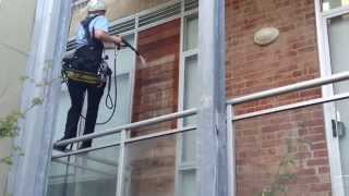 Abseiling while Pressure Washing