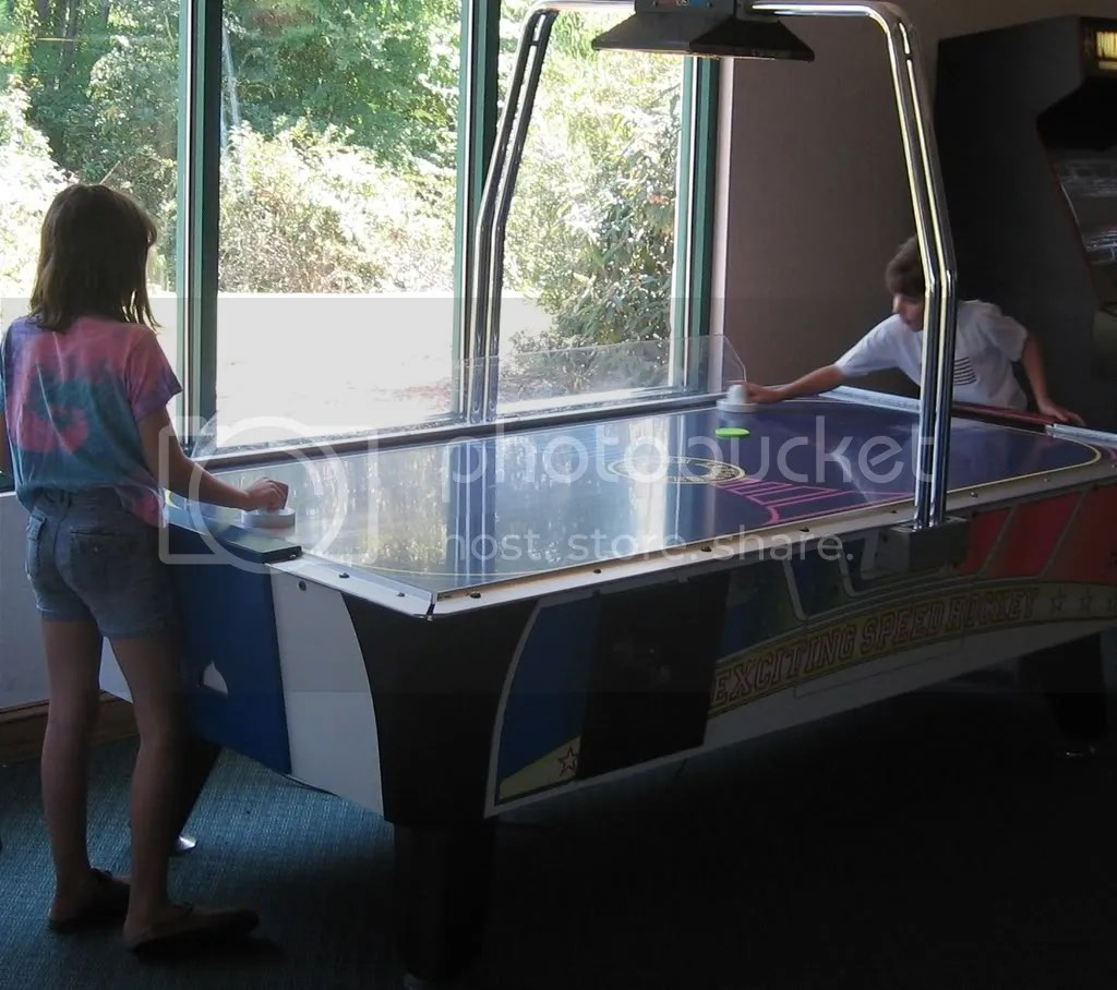 play ikoncity air hockey