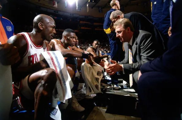 Michael Jordan and Larry Bird (1998 All-Star Game) BG : Dikembe Mutombo