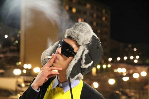 Bryanboy in Prada, smoking a cigarette.