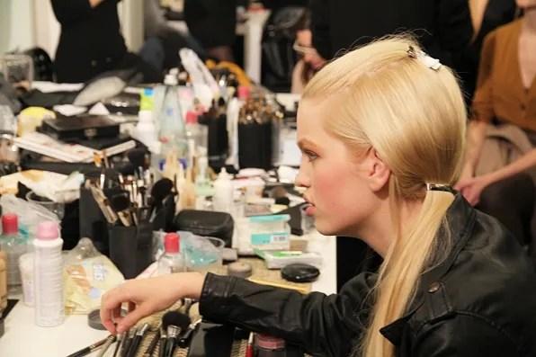Model Daphne Groeneveld doing hair and make up at Prada fall winter 2011