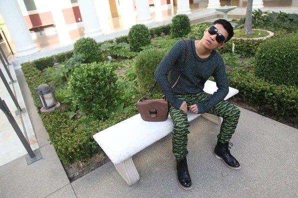 Bryanboy sitting on a bench at the Getty Villa inner peristyle garden