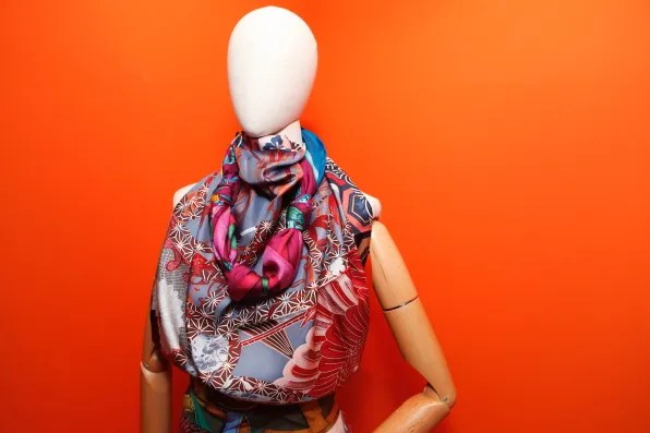 A mannequin styled with Hermes silk scarves