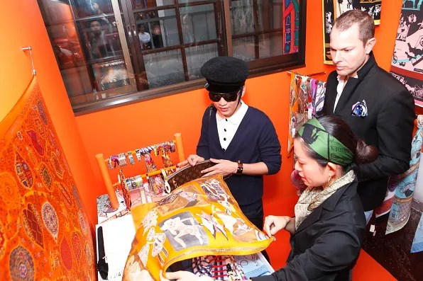 Hermes PR and Bryanboy looking at a silk scarf