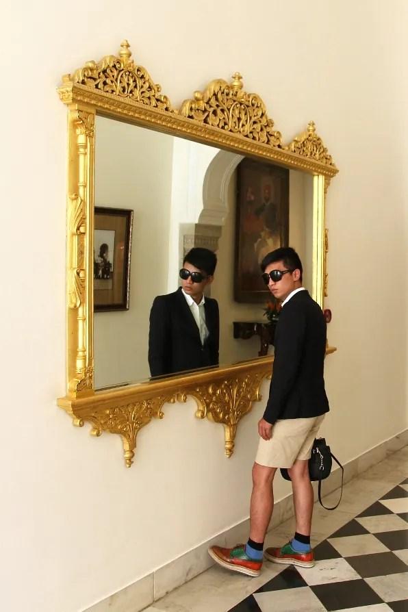 Bryanboy staring at a mirror at the Rambagh Palace hotel Jaipur