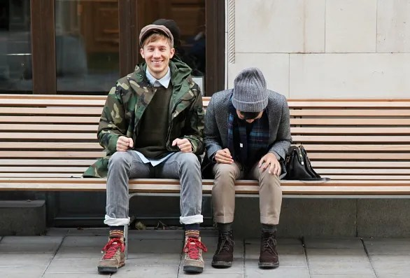 Fabian and Bryan sitting on a bench in Stockholm