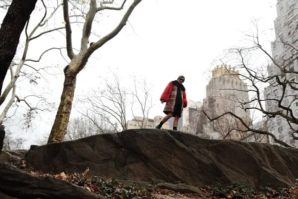 Bryanboy walking on top of rocks in Central Park