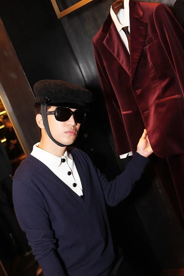 Bryanboy touching a Roberto Cavalli red velvet jacket