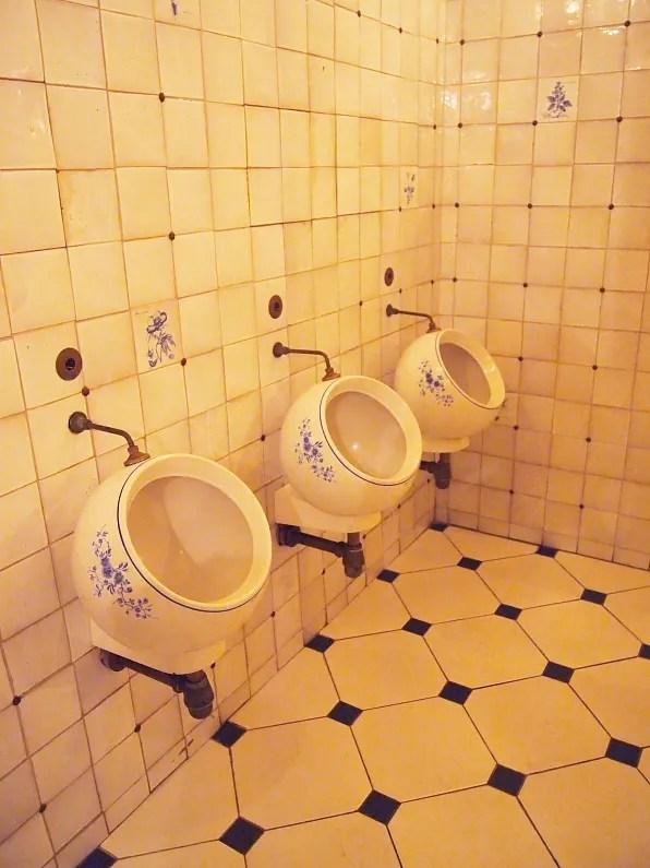 Porcelain men's toilet bowls at Tvrandot, Moscow