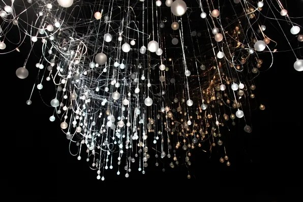 Lit up bulbs and wires at Alexander McQueen fall winter 2012