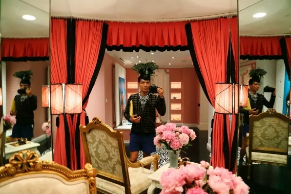Fashion blogger Bryanboy taking a picture of himself at the Plaza hotel, New York