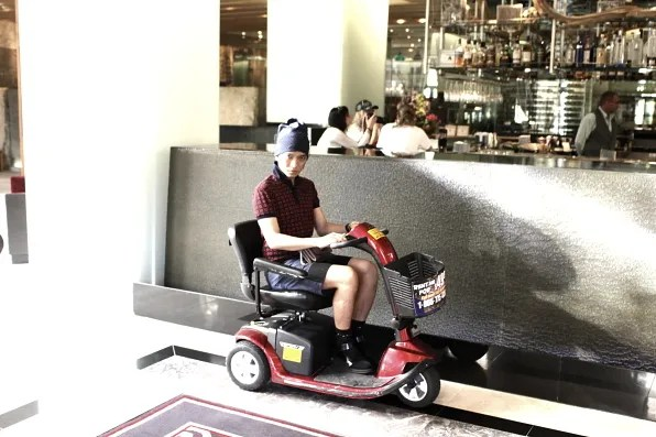 Bryanboy riding a small motor bike for obese people