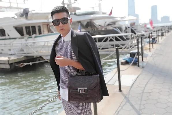 Bryanboy carrying a crocodile small dex bag by Oscar de la Renta