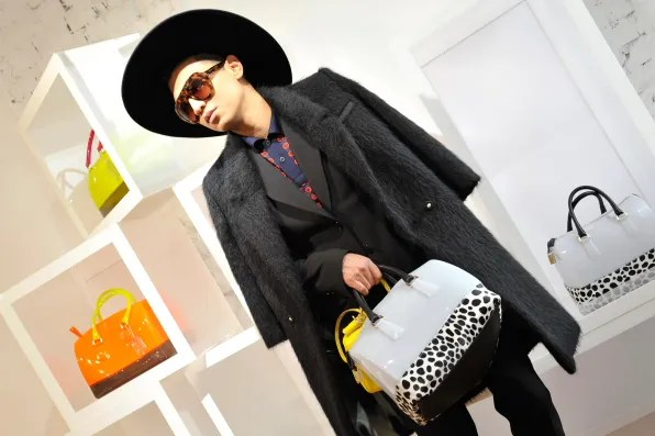 Bryanboy carrying a Furla Candy bag