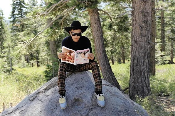 Bryanboy reading the September 2012 issue of Glamour magazine featuring Victoria Beckham on the cover.
