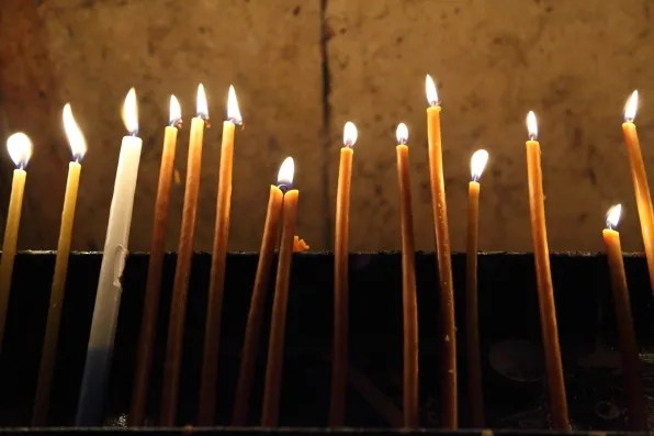 Lit candles at Church of the Holy Sepulchre