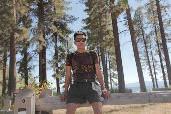 Bryanboy sitting on a wooden fence in Lake Tahoe, California