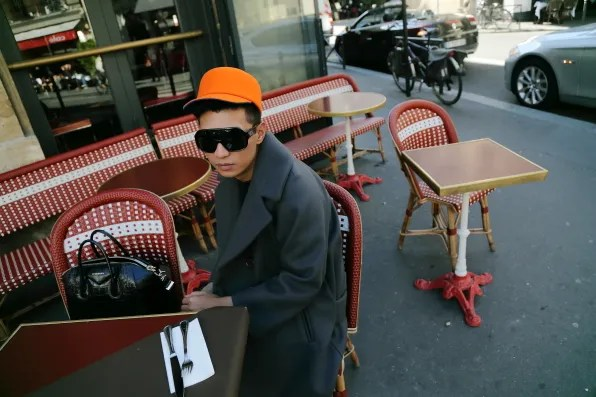 Bryanboy wearing an orange Kenzo hat
