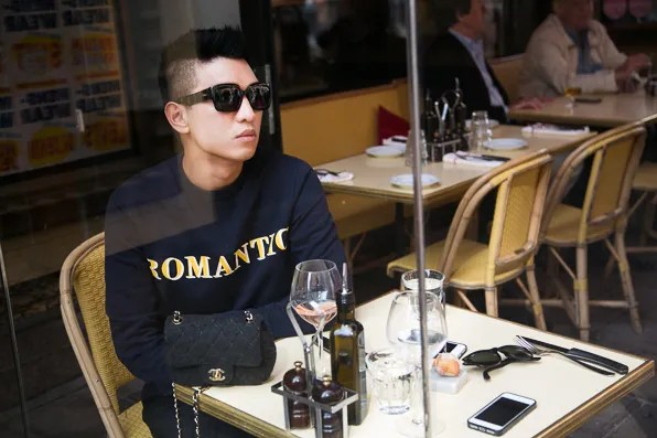 Bryanboy wears the Acne Romantic sweater at Zink Grill, Stockholm