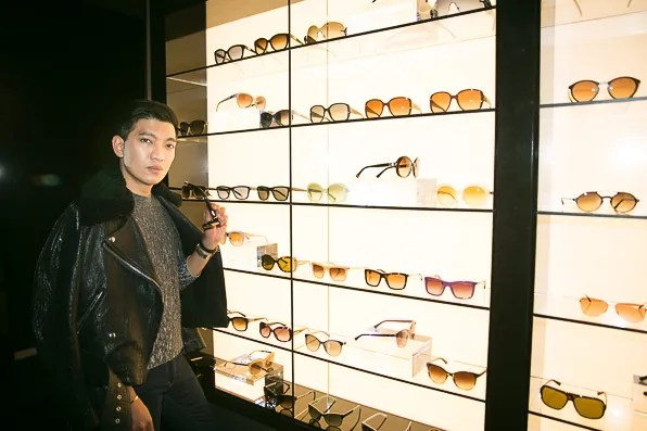 Bryanboy trying sunglasses at Armani Fifth Avenue New York City