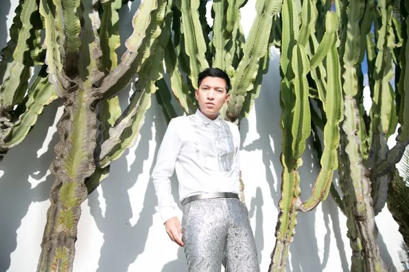 Bryanboy in silver brocade pants at the L'Amphitrite Palace, Skhirat, Morocco