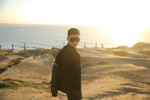 Bryanboy in La Jolla, California wearing a camouflage shirt