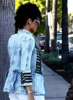 Rihanna wears Balmain Spring 2009 denim military jacket.