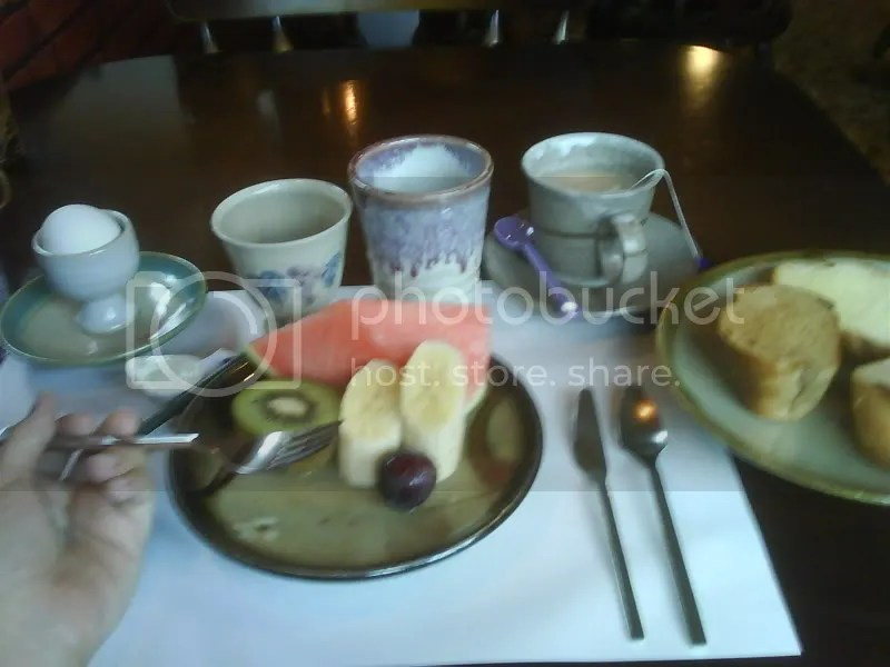 Fruit platter, hard-boiled egg and hot buttered toast
