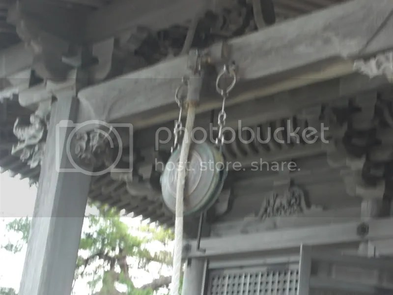 The bell which is hit with the rope. Not much of a sound. The 3 zodiac animals on the front of the shrine are snake, horse and goat.