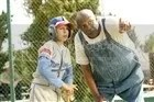 Angel (Jake T. Austin, left) and Cool Papa Bell (Louis Gossett Jr.) in THE PERFECT GAME.