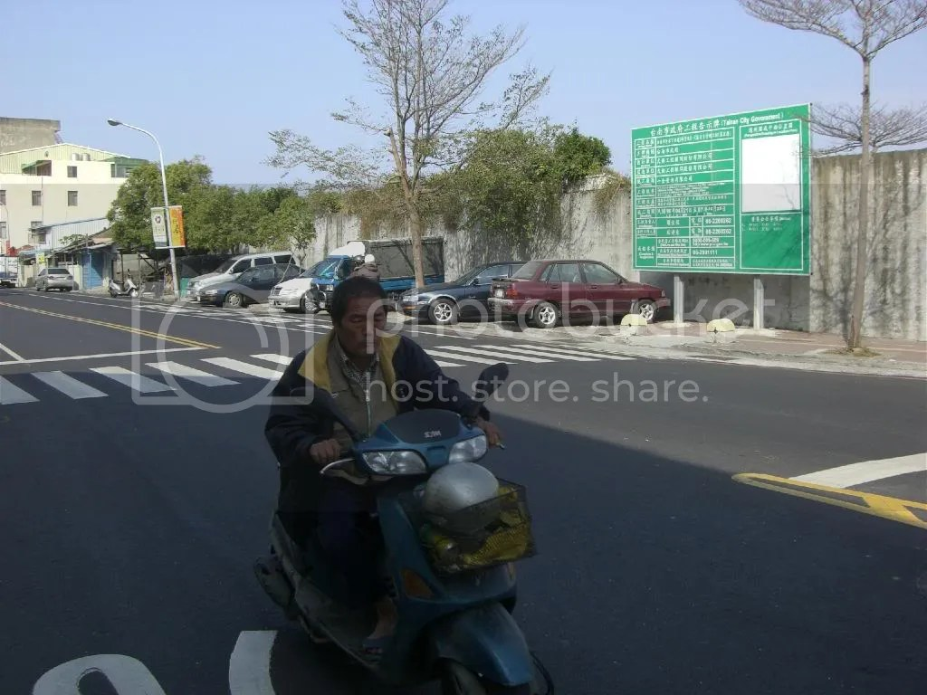 No helmets? I bet the Tainan policemen are TOO friendly and kind to give him a ticket.
